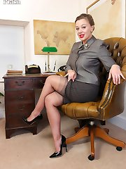Here's Beth at her desk clad in vintage lingerie with sheer grey FF nylons underneath her smart business suit.