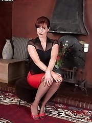 Insatiable, red head Holly in black satin corset and sheer red panties!