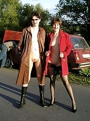 Two horny flashers near a car
