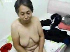 Japanese Grandma get clothed after sex