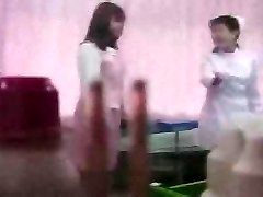 Asian lady unclothing on medical exam