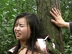 Chinese army dame corded to tree 2