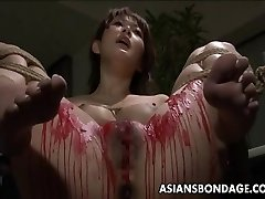 Asian babe get her privates covered in paraffin wax.