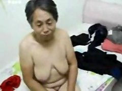 Asian Grandma get clad after sex