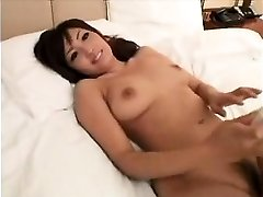 Stunning Oriental girl with charming big boobs gives a sensua