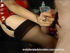 Tied-up and gagged stud has his cock gratified by an Asian bimbo