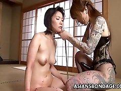 Tattooed up Oriental domina belt on fucking the sub