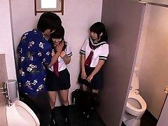 Japanese schoolgirls threeway fuck with fellow in restroom
