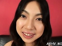 Beautiful oriental babe plays with playthings on clean-shaven pussy