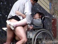 Horny Japanese nurse deep throats lollipop in front of a voyeur