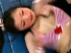 Sumptuous Japanese babes wrestle each other to tear off their cl