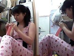 Chinese teenie inserts dildo