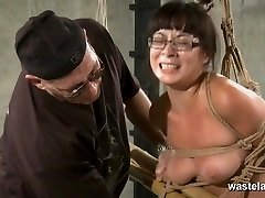 Trussed and tied sub in glasses has orgasms