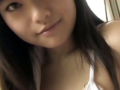Big-titted Japanese hottie shows her charms in white bikini
