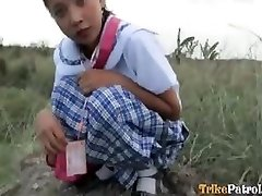Filipina schoolgirl torn up outdoors in open field by tourist