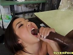 Asian little stunner sucking on two BBCs in trio