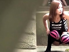 Japanese bitch urinate squats