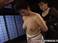 Mature bitch gets corded up and suspended in a bdsm session