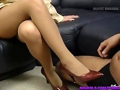 Yuuko Imai touches cock with feet in boots