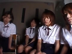 Four Japanese school chicks spitting on teacher