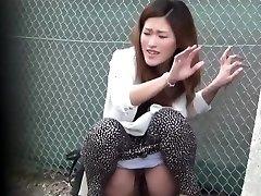 Oriental slut piss public