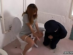 Bizarre Asian police officer getting face sat by a babe