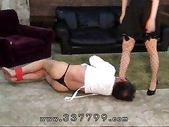 Asian femdom slaves penis in hot wax.