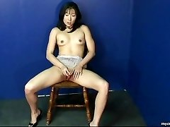 Wondrous  Asian babe rubbing on her wet labia