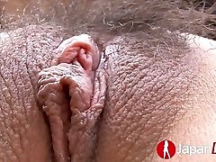 Slim Asian female with ball gag in her mouth gets toyed and finger-tickled