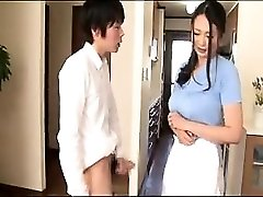 Delightful Asian housewife working her hands and lips on a