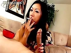Tia Ling likes to deepthroat on a ciggie and a hard cock at once