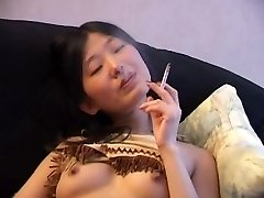 Japanese Smoking Naked on Couch