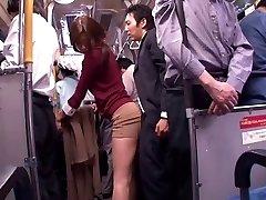 Japanese whore deep-throats bone in a public bus