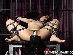 Spectacular girl is tied up and poked by big machine
