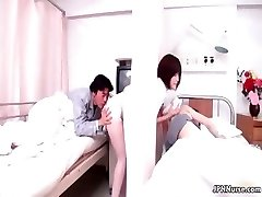 Beautiful Chinese nurse gives a patient some part3