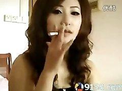 cute asian gal smoking