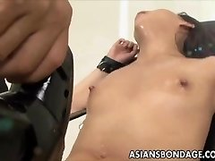 Japanese babe bond and fuckd by a poking machine