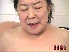 Chinese grandma enjoying sex