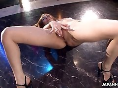 Asian stripper getting wild on the pole as she faps