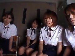 Four Japanese school chicks slobbering on teacher