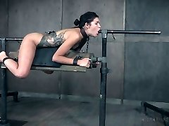 Restrain Bondage bitch Eden Sin gets her muff and asshole disciplined in the dark room