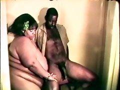 Big phat gigantic black bitch loves a rigid black cock between her lips and legs