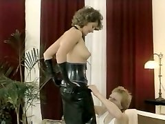 Hussy mistress in latex outfit gives deepthroat blow-job