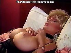 Blonde slut with monstrous tits fucks fellow
