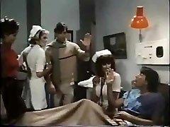 Nurse Parker handles patient to a oral job