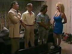 Huge-boobed blonde takes on two cocks and gets a double penetration