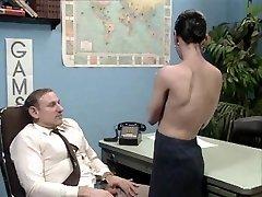 Older boss at desk job getting a blow job
