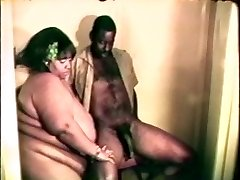 Big fat gigantic black bitch loves a firm dark-hued cock between her lips and legs