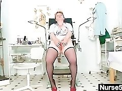 Dirty mature lady toys her hairy labia with speculum