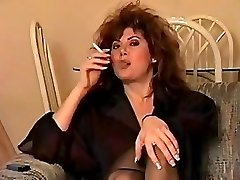 Classic early 90's smoking with big hair, perfect.